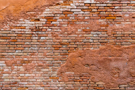 Old and damaged orange brown brick wall surface texture