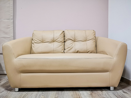 Brown polyurethane seat with two pillows in living room