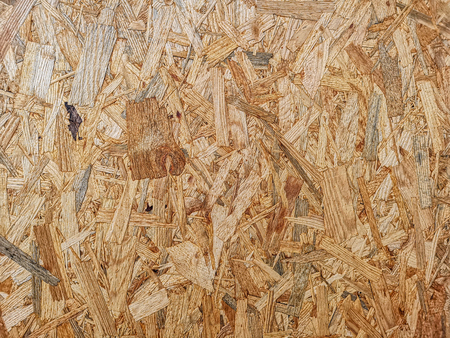 Brown oriented strand plywood board surface texture background