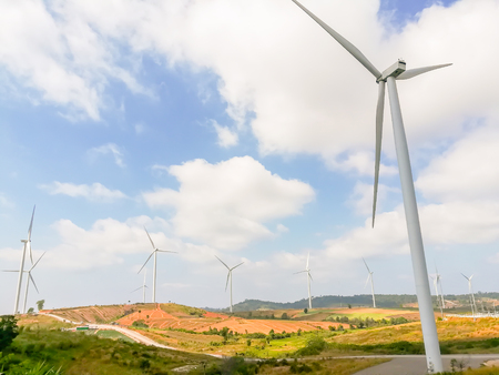 Electricity wind turbines field for generate alternative power with blue sky Stock Photo