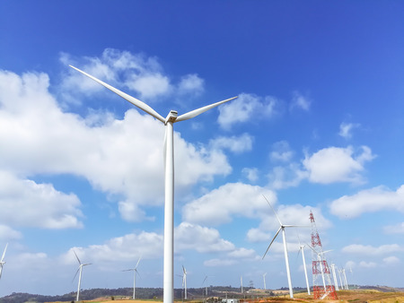 Electricity wind turbines field for generate alternative power with blue sky 写真素材