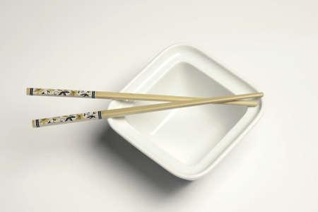 Chop sticks and white bowl