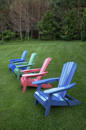 painted wood chairs on lawn in country
