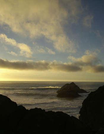 sun setting on the coast of california