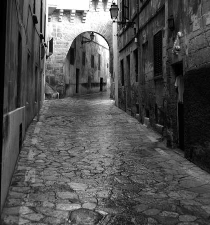 narrow street of spain in black and white Stock Photo