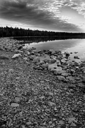 black and white shoreline of northern ontario lake