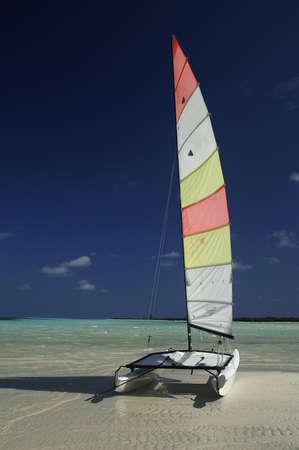 catamaran on beach waiting to sail Stock Photo