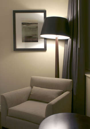 corner chair with lamp in hotel room