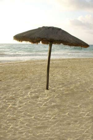 cabana: beach cabana standing alone in sand