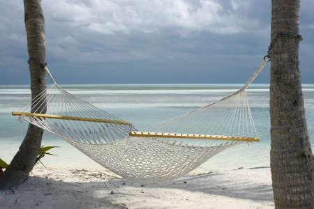 inviting hammock waiting for company on beach Stock Photo