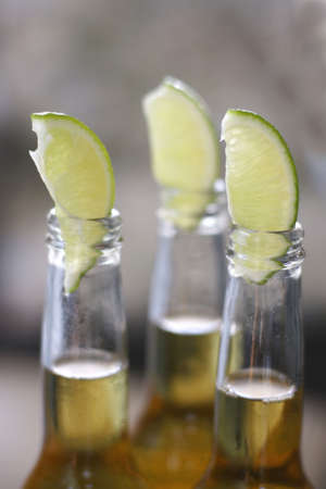 lime slices on top of beer bottles Stock Photo