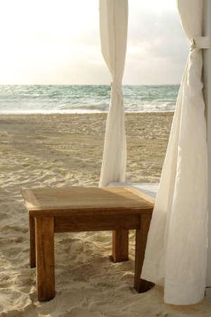 seaside table and cabana on beach