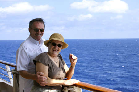 happy attractive senior couple on cruiseship 스톡 콘텐츠