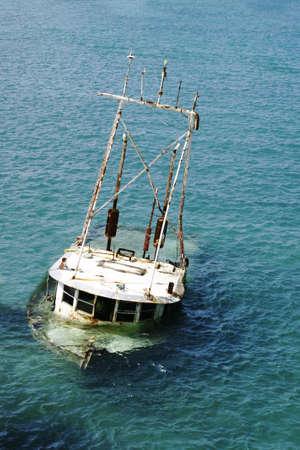 sunken boat: old sunken boat submerged in tropical waters