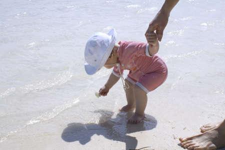 finding treasures along the beach shoreline Stock Photo