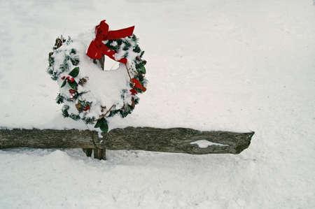 split rail: holiday wreath on split rail fence in snow