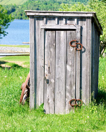 outhouse: old wooden outhouse by the river