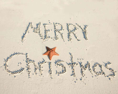 warm christmas greetings in the sand