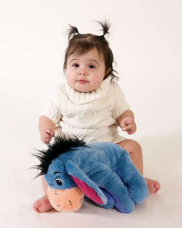 adorable baby girl with stuffed animal
