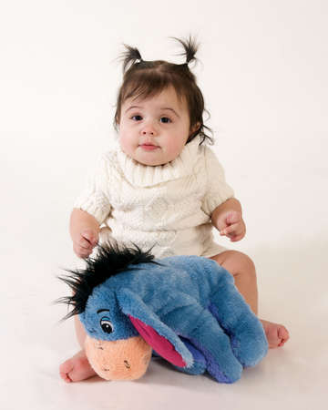 adorable baby girl with stuffed animal