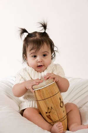 adorable baby girl with drum Stock Photo