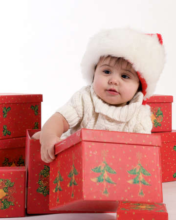 baby sitting in christmas boxes