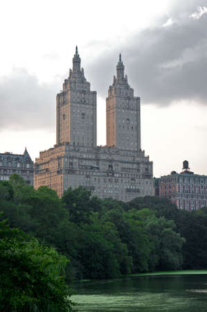 hotel towering over central park and lake