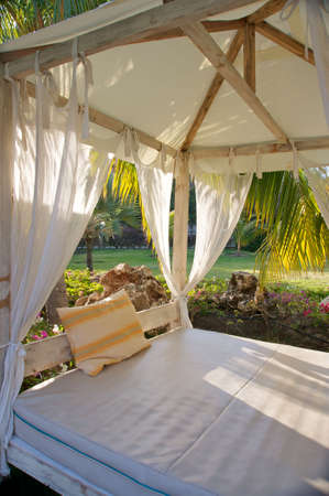 tropical canopy bed in gardens