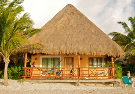 huts: tropical hut on the beach Stock Photo