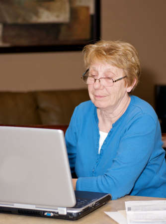 senior woman looking at a laptop Stock Photo