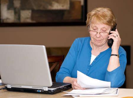 Senior woman filing taxes