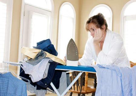 ironing too many shirts Stock Photo