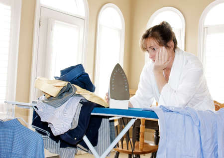 ironing too many shirts Stock Photo