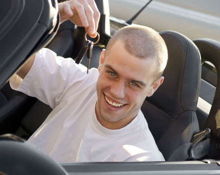 Young man with new sports car