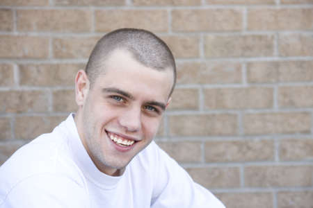 haircut: attractive smiling young male with fresh haircut