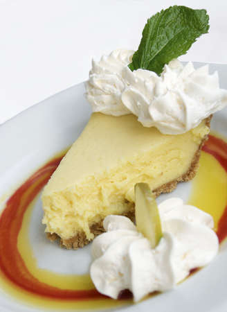 key lime pie slice on plate with whipped cream