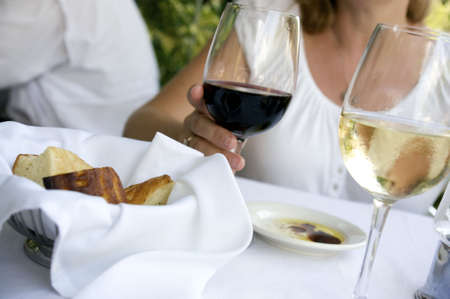 bread basket at a table setting with oil and wine Stock Photo - 4934023