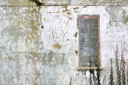 urban decay: Bricked up window in derelict building Stock Photo