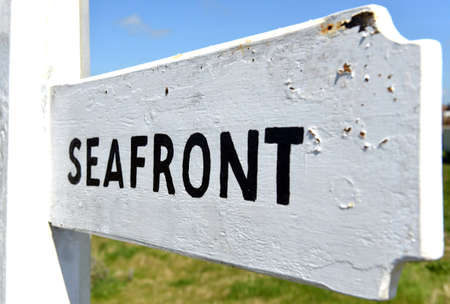 seafront: Seafront sign black on white traditional finger post