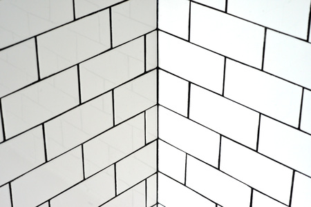 bathroom tiles: White vintage metro tiles and black grout in a bathroom
