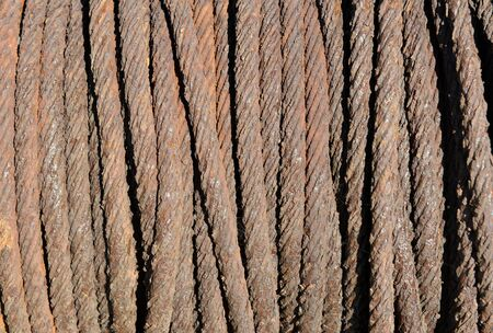 winch: Rusty metal rope on old boat winch Stock Photo
