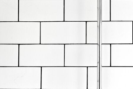 tile background: White vintage metro tiles and black grout in a bathroom