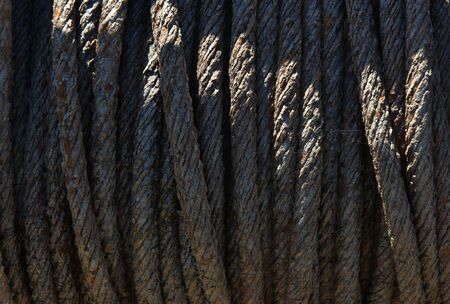 entropy: Rusty metal rope on old boat winch Stock Photo