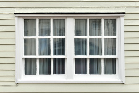 dickensian: Old sash window and weatherboarding on house Stock Photo