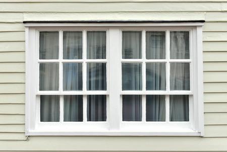 Old sash window and weatherboarding on house Stock Photo