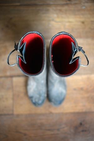 wellingtons: POV of wellington boots on wooden floor Stock Photo