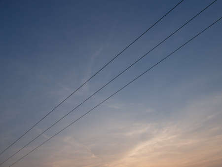 power cables: Triple power cables and sunset, blue sky