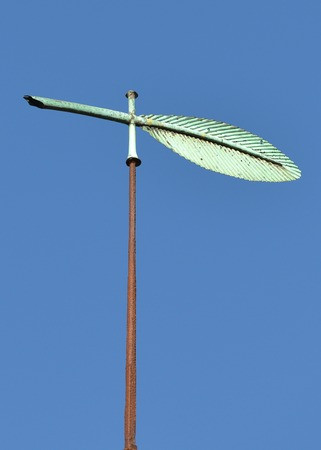 feather quill: Old green copper feather quill weather vane Stock Photo