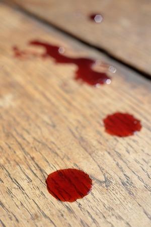 csi: Vivid blood drops on wooden oak floor