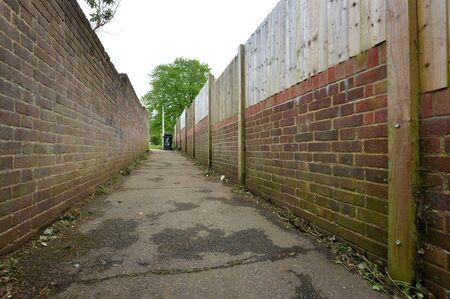 wheelie bin: Sinister alley way behind housing estate, uk